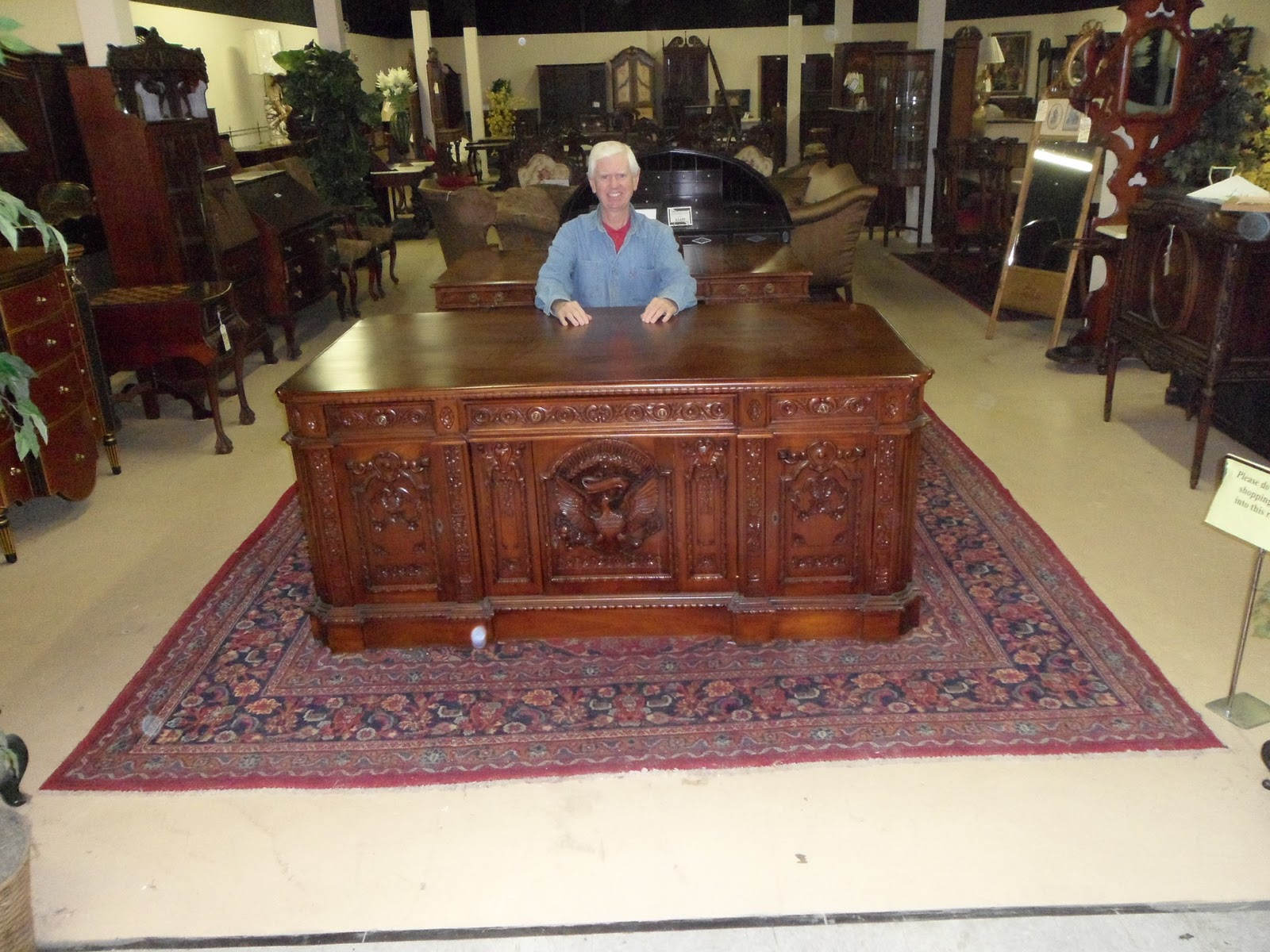 Replica Of A Resolute Desk On Display In An Antique Store